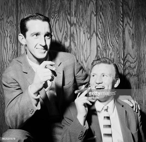 Everton football players Roy Vernon and Jimmy Gabriel smoking cigars as they celebrate their earlier 20 triumph over Leeds United in the FA Cup...