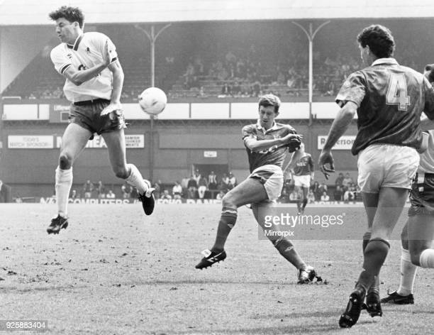 Everton footballer Kevin Sheedy chas a shot at goal blocked by Chelsea defenders during the League Division One match at Goodison Park 13th April 1991