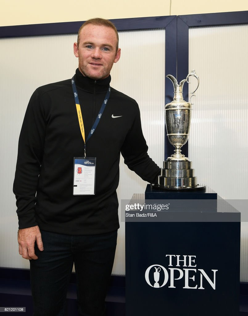 Everton footballer Wayne Rooney poses with the Claret Jug during the final round of the 146th Open Championship at Royal Birkdale on July 23, 2017 in Southport, England.