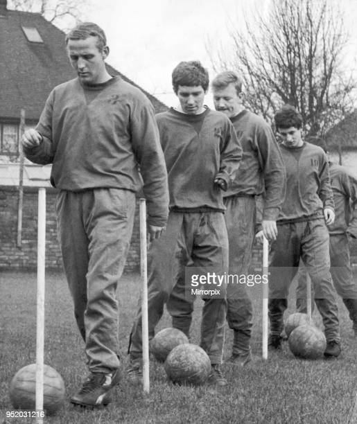 Everton footballers in dribbling practice at Bellefield ahead of their FA Cup fourth round match against Wolves Left to right are Alex Young Alan...