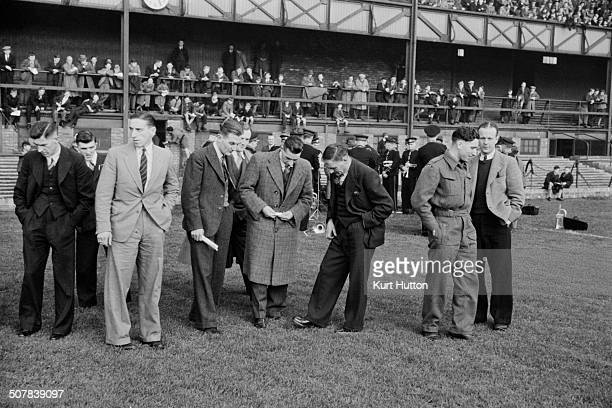 Everton footballers with trainer Harry Cooke inspect the pitch before a game against Sunderland at Roker Park Sunderland November 1945 The state of...