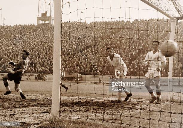 Everton goalkeeper Albert Dunlop is wellbeaten by a shot from Les Allen of Chelsea during their Division One football match at Stamford Bridge in...