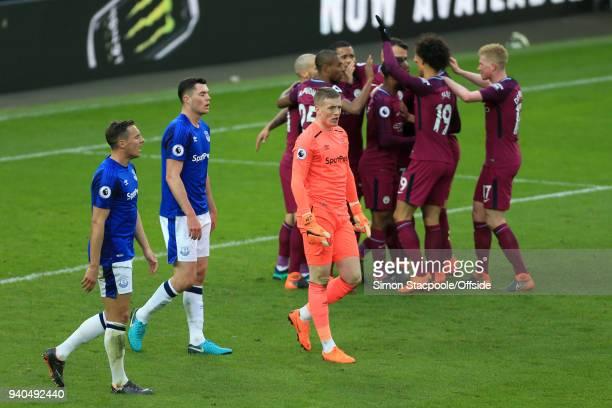Everton goalkeeper Jordan Pickford and defenders Phil Jagielka of Everton and Michael Keane of Everton look dejected following Man City's 3rd goal...