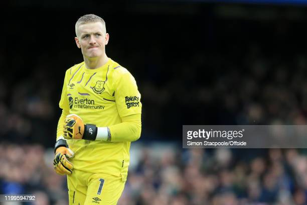 Everton goalkeeper Jordan Pickford celebrates victory after the Premier League match between Everton FC and Crystal Palace at Goodison Park on...