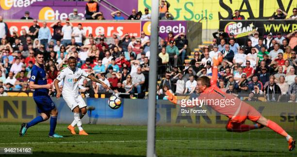 Everton goalkeeper Jordan Pickford is beaten for the Swansea goal by Jordan Ayew during the Premier League match between Swansea City and Everton at...