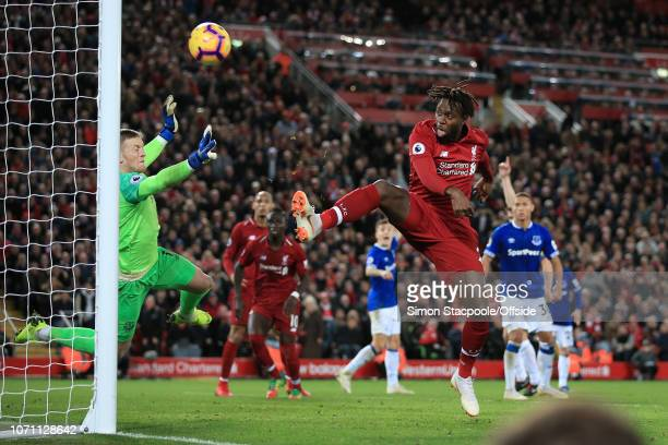 Everton goalkeeper Jordan Pickford is helpless as Divock Origi of Liverpool hits the bar from close range during the Premier League match between...
