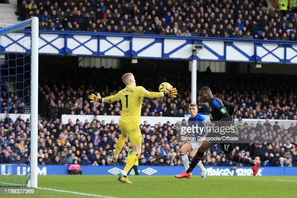 Everton goalkeeper Jordan Pickford saves at close range from Christian Benteke of Palace during the Premier League match between Everton FC and...