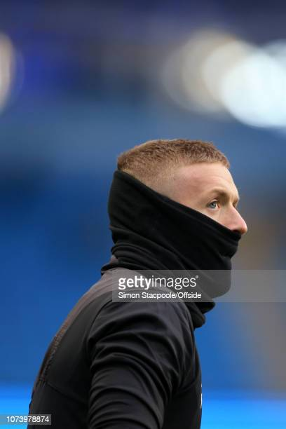 Everton goalkeeper Jordan Pickford wears a snood during the warmup ahead of the Premier League match between Manchester City and Everton at the...