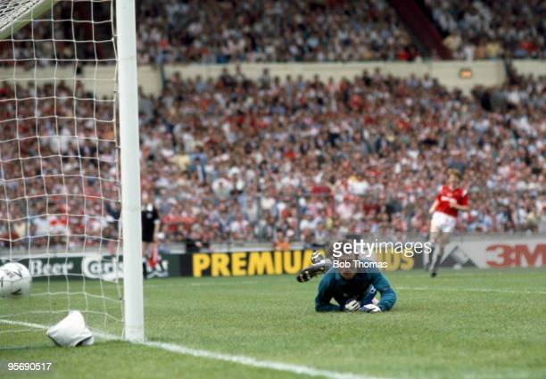 Everton goalkeeper Neville Southall is beaten by a shot from Manchester United's Norman Whitside during extratime in the FA Cup Final at Wembley...