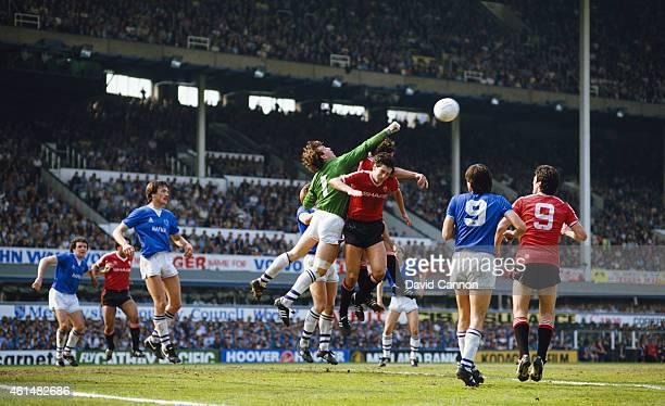 Everton goalkeeper Neville Southall punches clear during a League Division One match between Everton and Manchester United on May 5 1985 in Liverpool...
