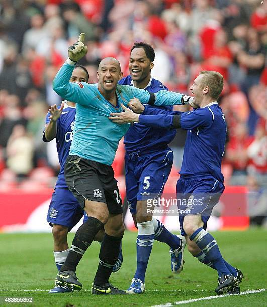 Everton goalkeeper Tim Howard celebrates with teammates Tony Hibbert Joleon Lescott and Steven Pienaar after victory in the penalty shoot out during...
