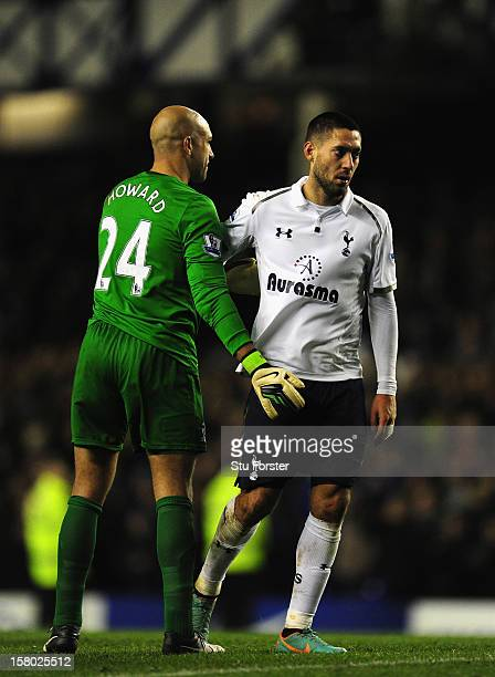Everton goalkeeper Tim Howard consoles Spurs player Clint Dempsey after during the Barclays Premier game between Everton and Tottenham Hotspur at...