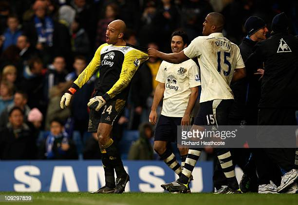 Everton goalkeeper Tim Howard is congratulated by teammate Sylvain Distin during the FA Cup sponsored by E.ON 4th round replay match between Chelsea...