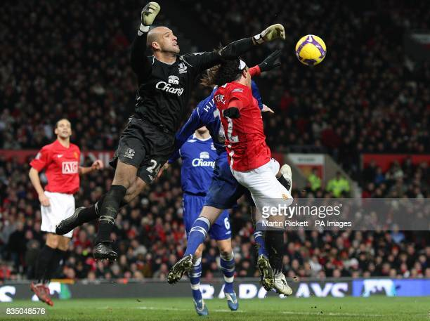 Everton goalkeeper Tim Howard jumps highest to punch the ball clear