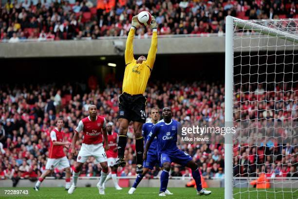 Everton goalkeeper Tim Howard stretches and grabs the ball out of the air during the Barclays Premiership match between Arsenal and Everton at The...