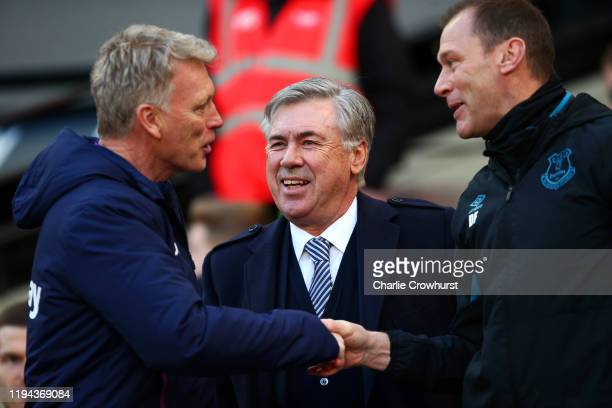 Everton Head Coach / Manager Carlo Ancelotti looks on as Assistant Duncan Ferguson shakes hands with West Ham United Manager / Head Coach David Moyes...