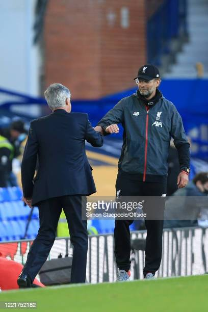 Everton manager Carlo Ancelotti and Liverpool manager Jurgen Klopp bump fists after the Premier League match between Everton FC and Liverpool FC at...