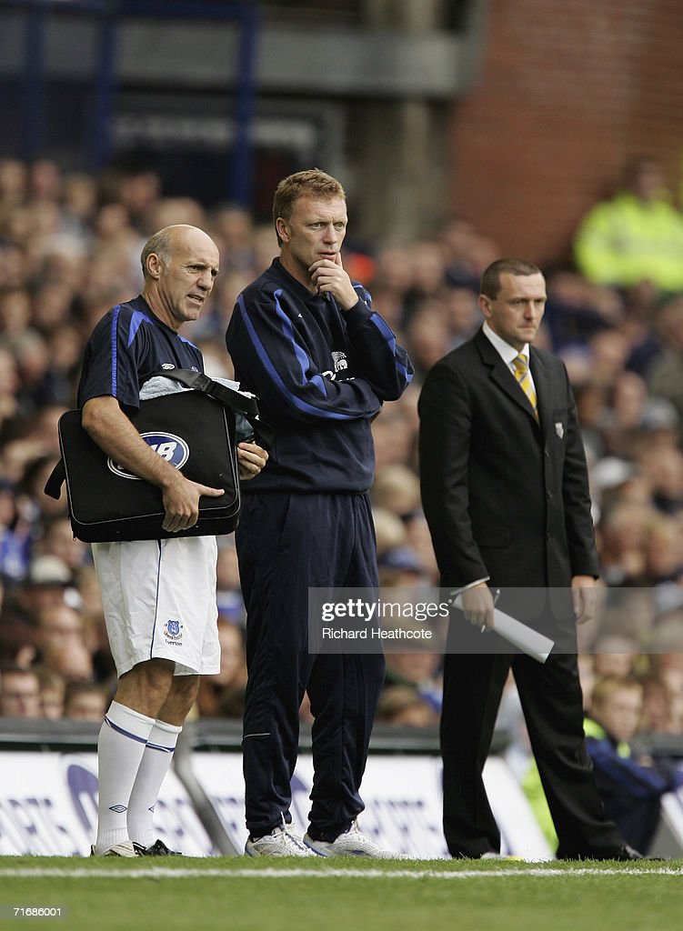 Everton manager David Moyes and Physio Mick Rathbone (L) look on during the Barclays Premiership match between Everton and Watford at Goodison Park on August 19, 2006 in Liverpool, England.
