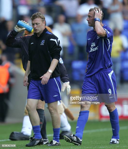 Everton manager David Moyes and striker Duncan Ferguson leave the pitch at halftime after confronting referee Alan Wiley.