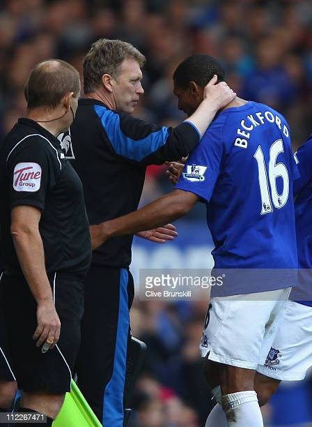 Everton manager David Moyes greets his striker Jermaine Beckford after substiituting him during the Barclays Premier League match between Everton and...