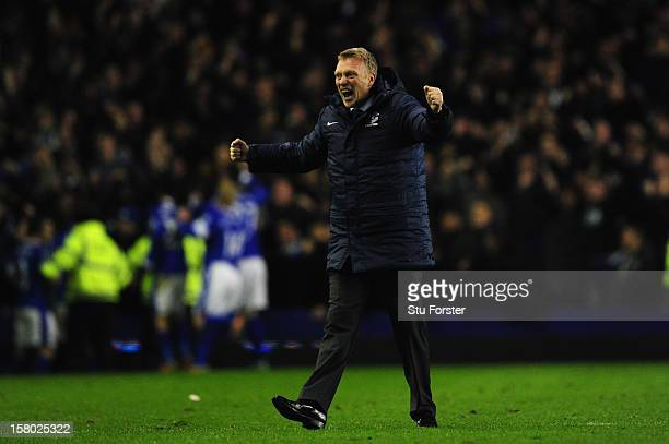 Everton manager David Moyes runs on the pitch to celebrate the winning goal during the Barclays Premier between Everton and Tottenham Hotspur at...