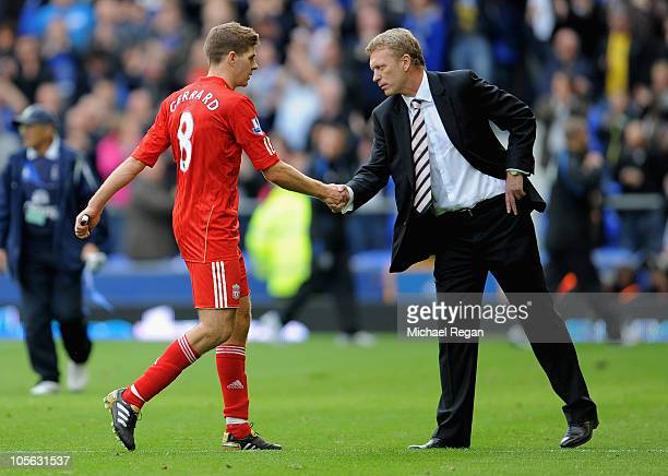 Everton manager David Moyes shakes Steven Gerrard of Liverpool's hand after the Barclays Premier League match between Everton and Liverpool at...