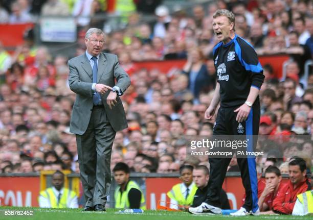 Everton manager David Moyes shouts instructions to his team as Manchester United manager Alex Ferguson gestures to the officials regarding the amount...