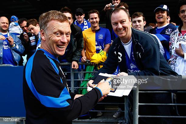 Everton manager David Moyes signs autographs following a Evertone training session at ANZ Stadium on July 9 2010 in Sydney Australia