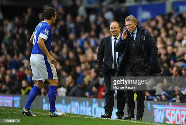 Everton Manager David Moyes speaks to Phil Jagielka as Chelsea Manager Rafael Benitez looks on during the Barclays Premier League match between...