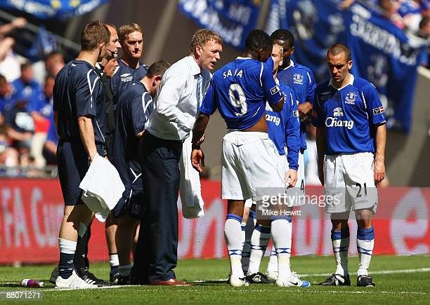 Everton manager David Moyes talks to Louis Saha of Everton during the FA Cup sponsored by EON Final match between Chelsea and Everton at Wembley...