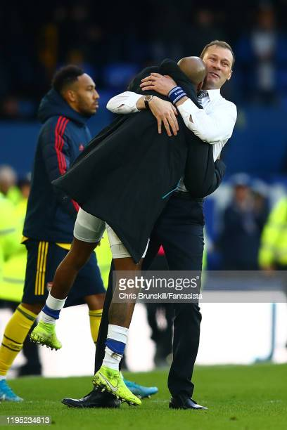 Everton manager Duncan Ferguson embraces Fabian Delph following the Premier League match between Everton FC and Arsenal FC at Goodison Park on...