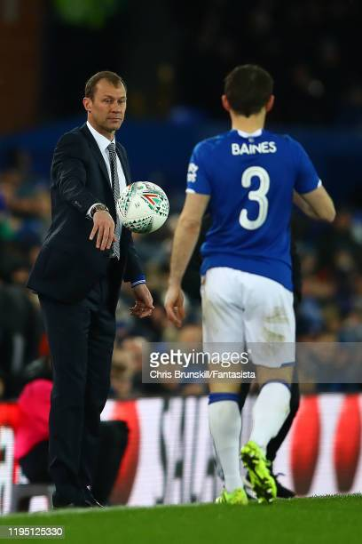 Everton manager Duncan Ferguson throws the ball to Leighton Baines during the Carabao Cup Quarter Final match between Everton FC and Leicester FC at...