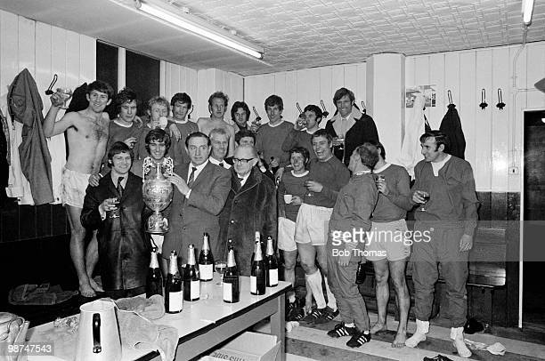 Everton manager Harry Catterick and his team celebrate with the First Division Championship in the dressing room at Goodison Park after a 2-0 victory...