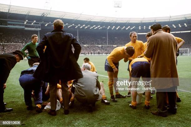 Everton manager Harry Catterick talks to John Hurst Jimmy Husband Joe Royle Ray Wilson and Tommy Wright as Sandy Brown looks over to goalkeeper...