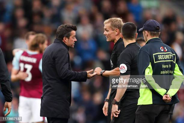 Everton manager / head coach Marco Silva confronts match referee Graham Scott at full time of the Premier League match between Burnley FC and Everton...