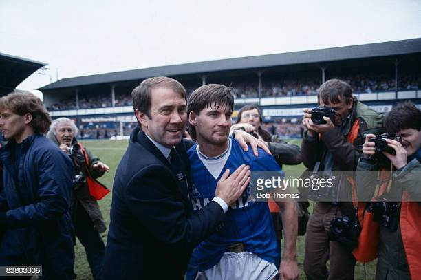 Everton Manager Howard Kendall congratulates Paul Bracewell after their 2-0 vicyory over Queens Park Rangers at Goodison Park had clinched the First...