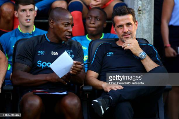 Everton manager Marco Silva looks on next to assistant manager Luis Boa Morte during the Pre-Season Friendly match between Wigan Athletic and Everton...