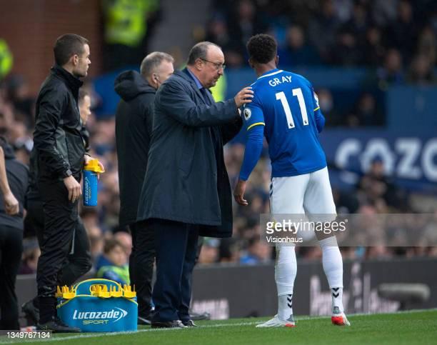 Everton manager Rafael Benítez talks to Demarai Gray during the Premier League match between Everton and Watford at Goodison Park on October 23, 2021...