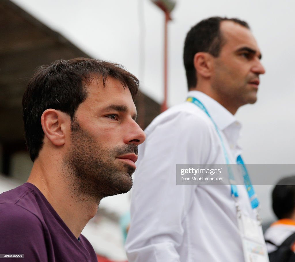 Everton Manager, Roberto Martinez and former Netherlands striker, Ruud van Nistelrooy speak as they watch the action during the Netherlands training session at the 2014 FIFA World Cup Brazil held at the Estadio Jose Bastos Padilha Gavea on June 10, 2014 in Rio de Janeiro, Brazil.