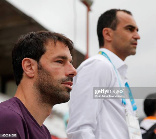 Everton Manager Roberto Martinez and former Netherlands striker Ruud van Nistelrooy speak as they watch the action during the Netherlands training...