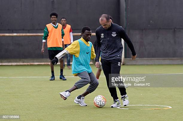 Everton manager Roberto Martinez coaches a group of refugees during an Everton in the Commity Project on December 14 2015 in Liverpool England