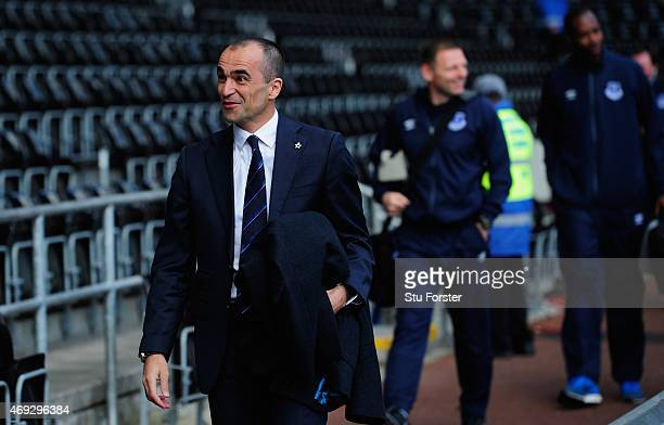 Everton manager Roberto Martinez raises a smile as the team turn up at the stadium before the Barclays Premier League match between Swansea City and...