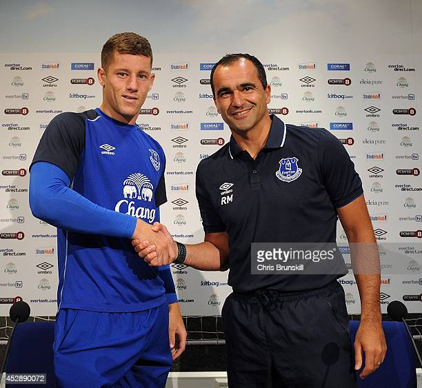 Everton manager Roberto Martinez shakes hands with Ross Barkley during a press conference at Finch Farm on July 29, 2014 in Liverpool, England.