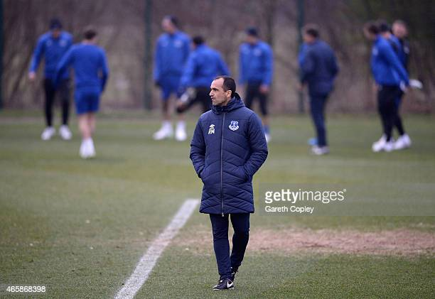 Everton manager Roberto Martinez watches on during a training session at Finch Farm on March 11 2015 in Halewood England