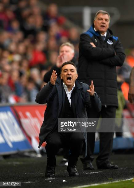Everton manager Sam Allardyce looks on as Swansea manager Carlos Carvalhal reacts during the Premier League match between Swansea City and Everton at...