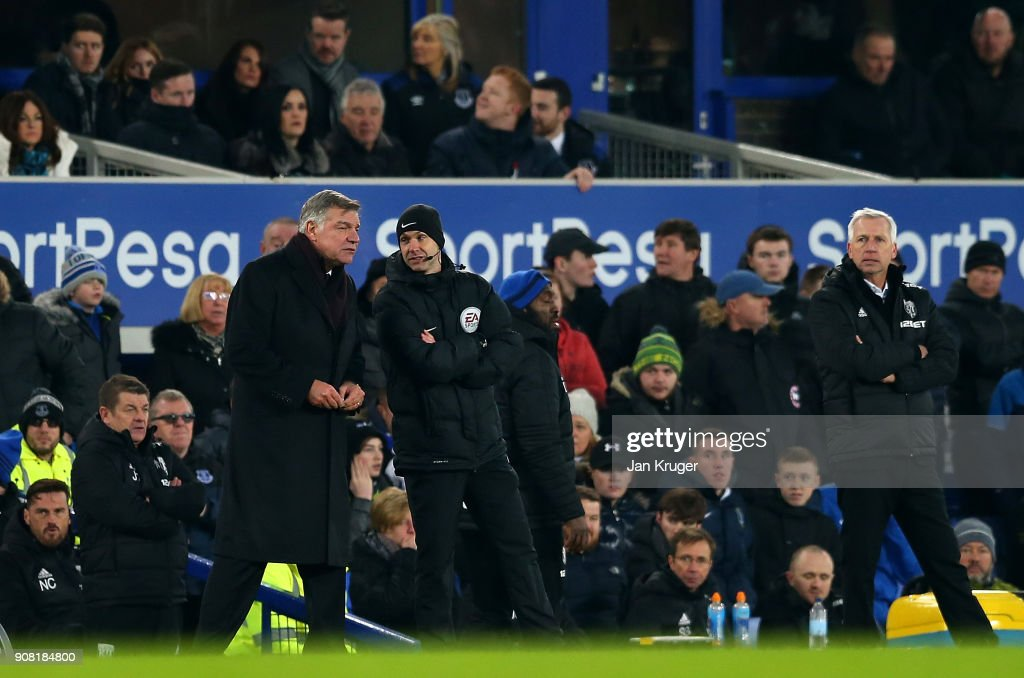 Everton manager Sam Allardyce speaks with 4th official Anthony Taylor during the Premier League match between Everton and West Bromwich Albion at Goodison Park on January 20, 2018 in Liverpool, England.