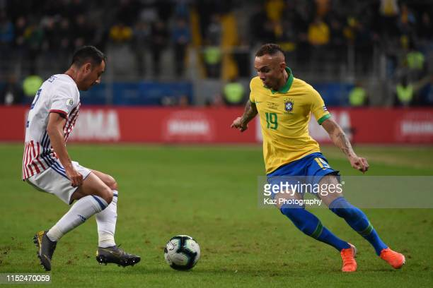 Everton of Brasil and Ivan Piris of Paraguay compete for the ball during the Copa America Brazil 2019 quarterfinal match between Brazil and Paraguay...