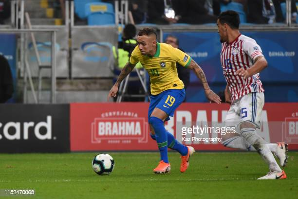 Everton of Brasil dribbles the ball under the pressure from Gustavo Gomez of Paraguay during the Copa America Brazil 2019 quarterfinal match between...