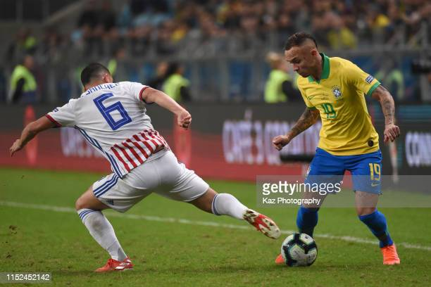 Everton of Brasil dribbles the ball uner the challenge from Richard Guerrero of Paraguay during the Copa America Brazil 2019 quarterfinal match...