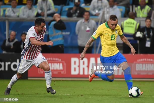 Everton of Brazil beats Ivan Piris of Paraguay during the Copa America Brazil 2019 quarterfinal match between Brazil and Paraguay at Arena do Gremio...